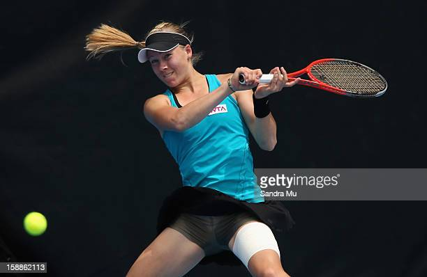 Johanna Larsson of Sweden plays a forehand in her second round match against Julia Goerges of Germany during day three of the 2013 ASB Classic on...