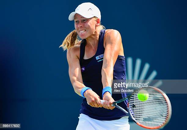 Johanna Larsson of Sweden returns a shot during a match against Roberta Vinci of Italy on day 5 of the Connecticut Open at the Connecticut Tennis...