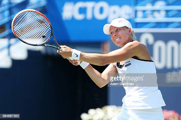 Johanna Larsson of Sweden returns a shot during her match against Shelby Rogers of the United States on day 4 of the Connecticut Open at the...