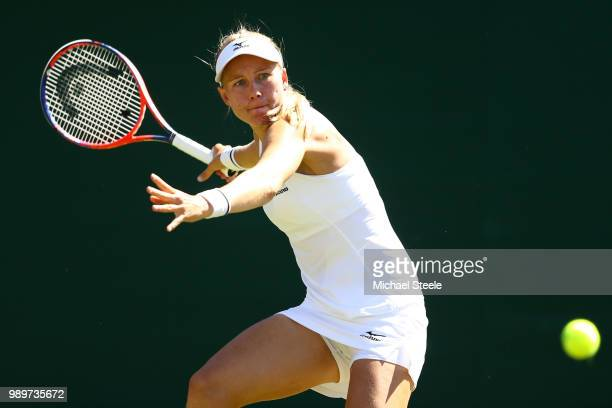 Johanna Larsson of Sweden returns to Venus Williams of the United States during their Ladies' Singles first round match on day one of the Wimbledon...