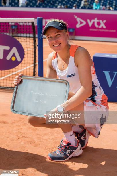 Johanna Larsson poses with the trophy after winning doubles tournament with Kiki Bertens during the Finals of WTA Ladies Championship Gstaad on July...