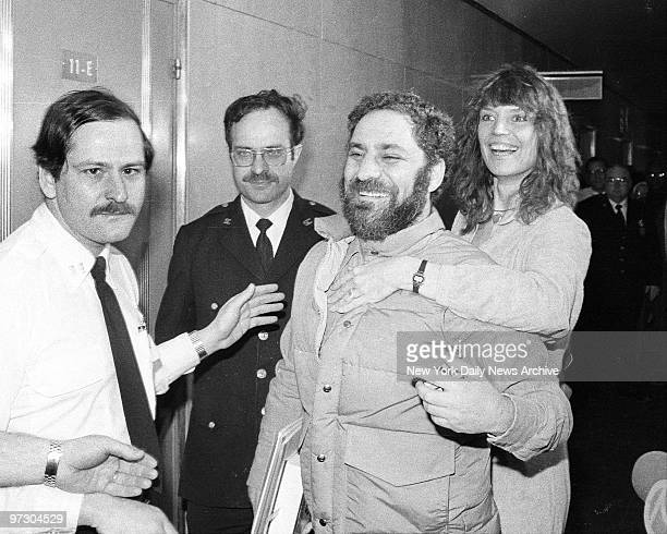 Johanna Lawrenson hugs Abbie Hoffman at Manhattan Supreme Court as he surrenders to Dept of Correction officer and court officer to begin threeyear...