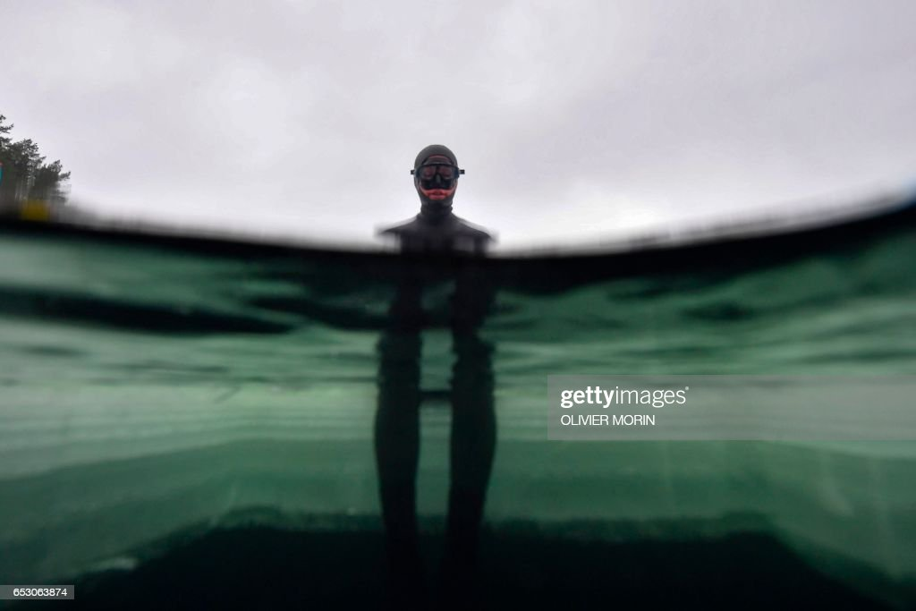 Johanna Nordblad, 42, Finnish freediver gets concentrated before Ice-freediving training session on February 28, 2017, in a green lake in Somero (southwest Finland). The ice is about 45cm thick, wa...