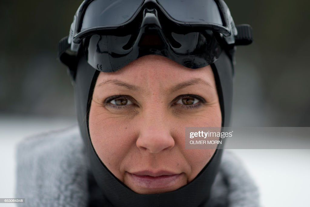CORRECTION - Johanna Nordblad, 42, Finnish freediver poses on a frozen lake before a Ice-freediving training session on February 28, 2017, in Somero (southwest Finland). The ice is about 45cm thick, water temperature +1°C. Johanna Nordblad holds the world record of freediving under ice with bathing suit with 50m distance. / AFP PHOTO / OLIVIER MORIN / TO GO WITH AFP STORY BY Sabine COLPART / The erroneous mention[s] appearing in the metadata of this photo by OLIVIER MORIN has been modified in AFP systems in the following manner: [---] instead of [---]. Please immediately remove the erroneous mention[s] from all your online services and delete it (them) from your servers. If you have been authorized by AFP to distribute it (them) to third parties, please ensure that the same actions are carried out by them. Failure to promptly comply with these instructions will entail liability on your part for any continued or post notification usage. Therefore we thank you very much for all your attention and prompt action. We are sorry for the inconvenience this notification may cause and remain at your disposal for any further information you may require.