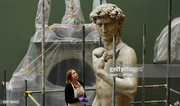 Johanna Puisto sculpture conservator at The VA unveils a cast of Michelangelo's David at Victoria Albert Museum on November 10 2014 in London England