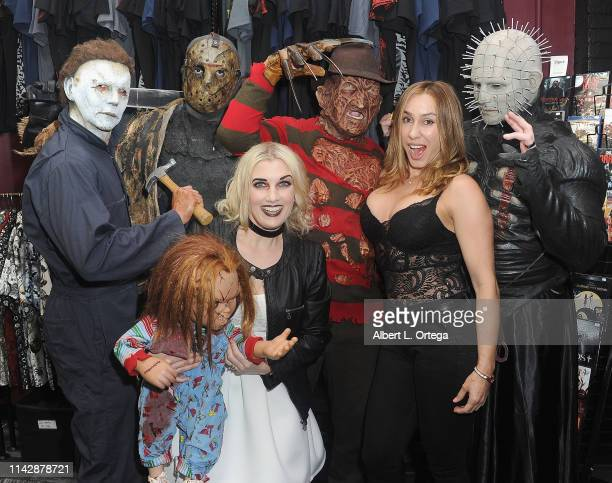 Johanna Rae poses with Michael Myers Jason Voorhees Freddy Kreuger Pinhead and Tiffany at the Dark Delicacies Grand Opening Party held at Dark...