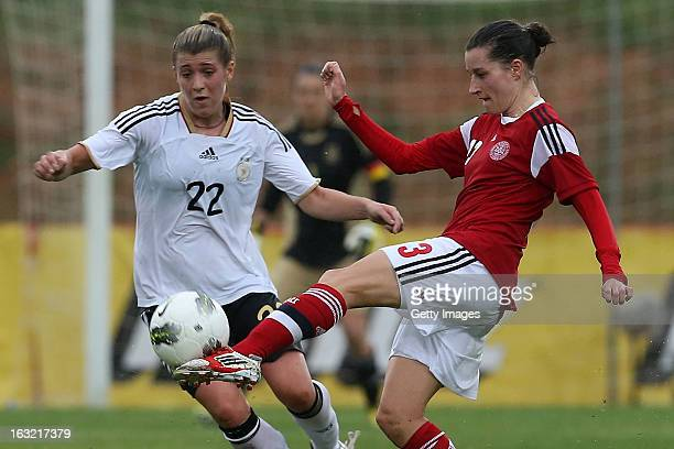 Johanna Rasmussen of Denmark challenges Luisa Wensing of Germany during the Algarve Cup macth between Denmark and Germany at the Estadio Municipal de...