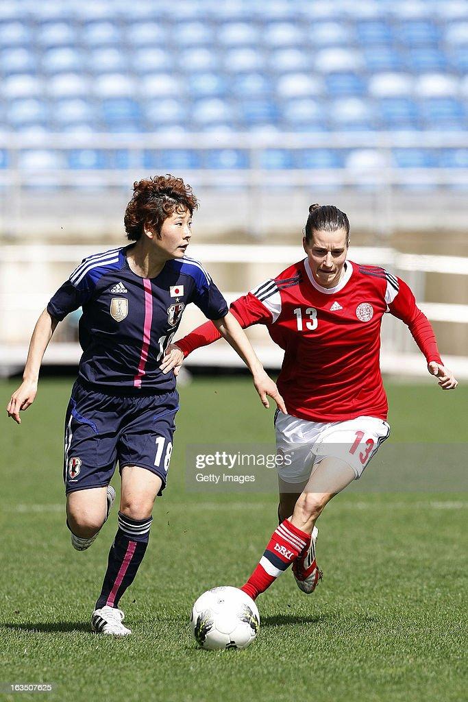 Johanna Rasmussen of Denmark challenges Yuka Kado of Japan during the Algarve Cup 2013 match between Denmark and Japan at the Algarve stadium on March 11, 2013 in Faro, Portugal.