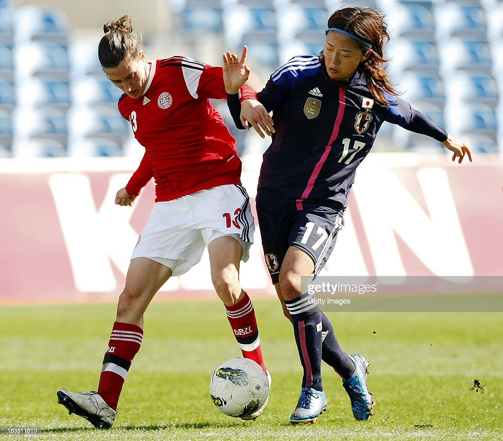 Johanna Rasmussen (L) of Denmark challenges Yuki Ogimi of Japan during the Algarve Cup 2013 match between Denmark and Japan at the Algarve stadium on March 11, 2013 in Faro, Portugal.
