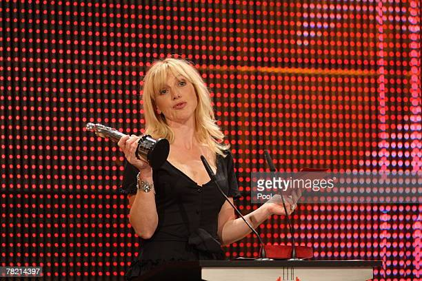 Johanna ter Steege holds her trophy on stage during the 20th European Film Ceremony at the Arena on December 1 2007 in Berlin Germany
