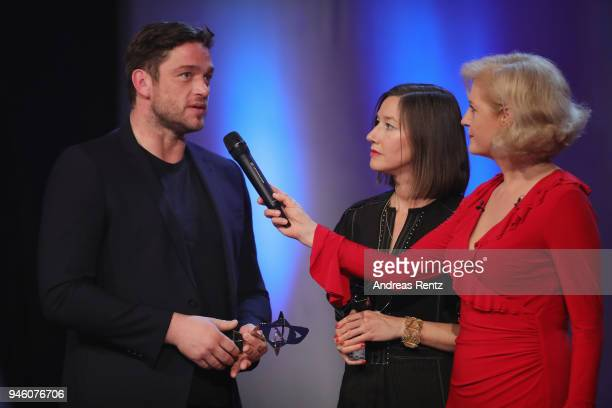 Johanna Wokalek and Ronald Zehrfeld chats with host Annette Gerlach on stage during the 54th Grimme Award on April 13 2018 in Marl Germany
