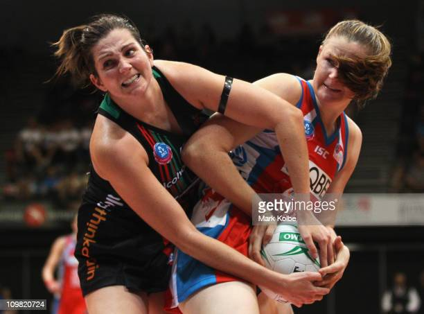 Johannah Curran of the Fever and Susan Pratley of the Swifts fight for the ball during the round four ANZ Championship match between the Sydney...