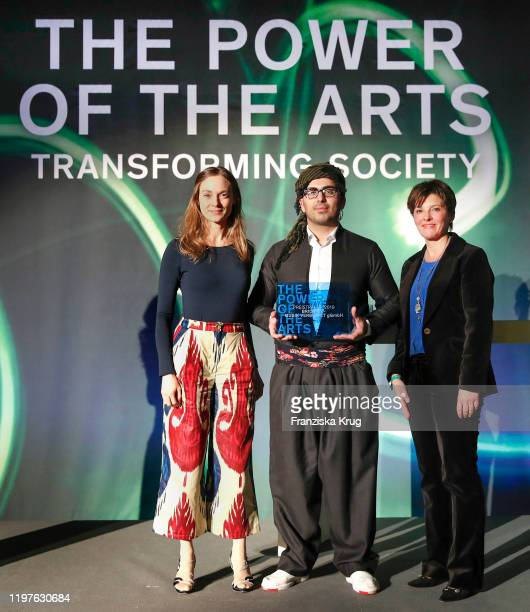 """Johanna-Leonore Dahlhoff, Reza Rostami from Bridges - 'Musik verbindet GmbH' and Elfriede Buben during the award ceremony """"The Power of the Arts by..."""
