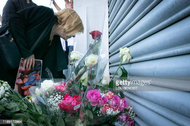 Johanna's mother brings flower where her daughter has been killed during a rally to denounce femicides and domestic violence in Le Havre northwestern...