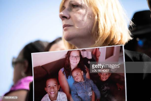 Johanna's mother looks on as she holds a picture of her daughter in her hands during a rally to denounce femicides and domestic violence in Le Havre...