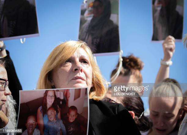 Johanna's mother looks on with a picture of her daughter in her hands during a rally to denounce femicides and domestic violence in Le Havre...