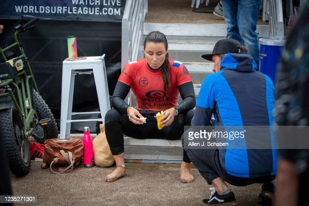 Johanne Defay of France, eats a banana and rests after beating 7-time WSL champion Stephanie Gilmore of Australia at the Rip Curl WSL Finals Tuesday,...