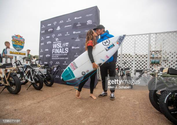 Johanne Defay of France, gets a kiss before competing against 7-time WSL champion Stephanie Gilmore of Australia at the Rip Curl WSL Finals Tuesday,...