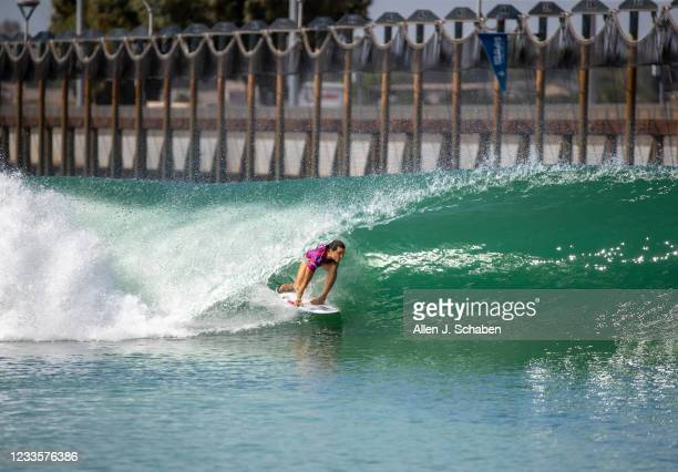 Johanne Defay, of France, gets a long barrel ride to defeating reigning Surf Ranch champion and four-time world champion Carissa Moore, of Hawaii,...