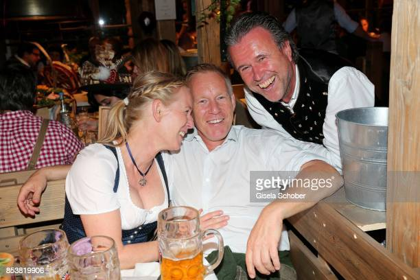 Johannes B. Kerner and his sister Julia and Thomas Schreiner, CEO Laurent-Perrier Champagner during the Oktoberfest at Kaeferzelt at Theresienwiese...