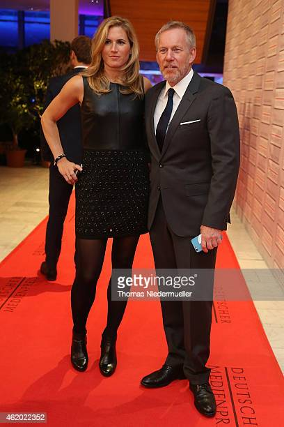 Johannes B Kerner and his wife Britta Becker arrive the red carpet during the German Media Award 2014 on January 23 2015 in BadenBaden Germany