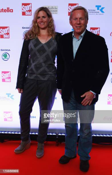 Johannes B Kerner and his wife Britta BeckerKerner attend the Sport Bild Award 2011 at the Fischauktionshalle on August 8 2011 in Hamburg Germany