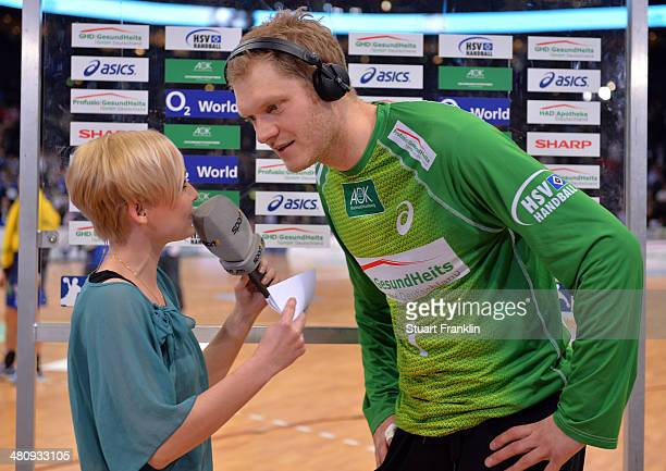 Johannes Bitter of Hamburg handball team during an interview with Anett Sattler of Sport 1 at the DKB Bundesliga handball match between HSV Handball...