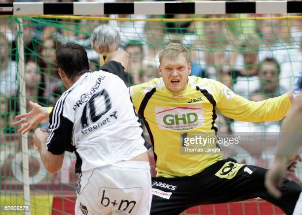 Johannes Bitter of Hamburg saves a penalty thrown by Stefan Loevgren of Kiel during the Super Cup match between THW Kiel and HSV Hamburg at the...