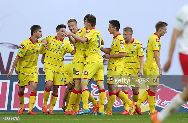 Johannes Buehler of Hoffenheim jubilates with team mates after scoring the fived goal during the U19 A Juniors Bundesliga semi final match between RB...