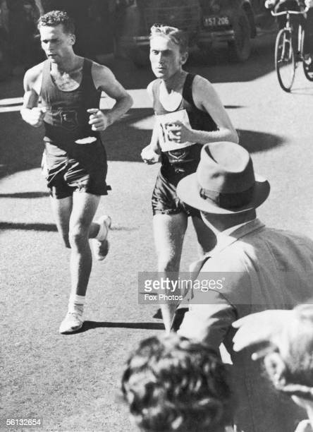 Johannes Coleman and Jackie Gibson both of South Africa pass the ten mile mark at Rockdale during the marathon event at the British Empire Games in...