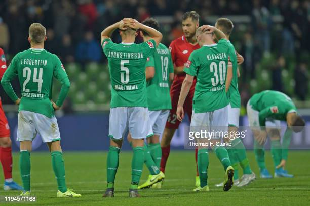 Johannes Eggestein Ludwig Augustinsson Milos Veljkovicand Davy Klaassen of Bremen look dejected after losing the Bundesliga match between SV Werder...