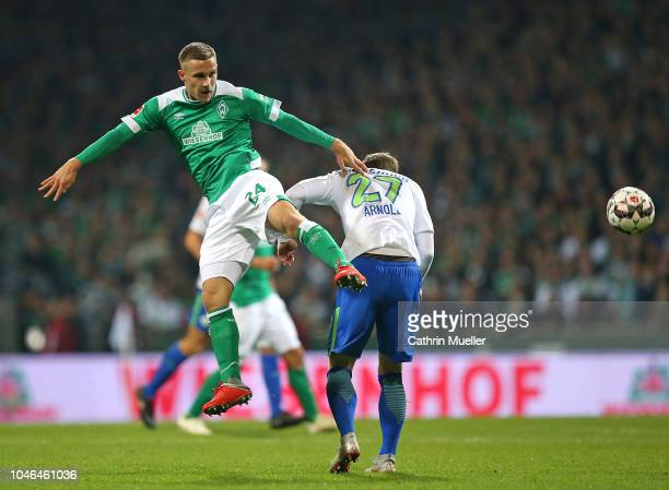 Johannes Eggestein of Bremen and Maximilian Arnold of Wolfsburg battle for the ball during the Bundesliga match between SV Werder Bremen and VfL...