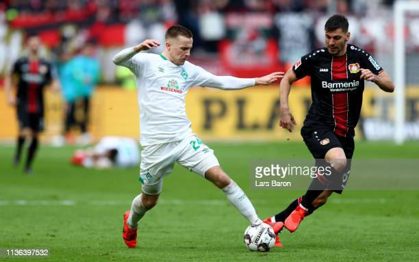Johannes Eggestein of Bremen is challenged by Aleksandar Dragovic of Bayer Leverkusen during the Bundesliga match between Bayer 04 Leverkusen and SV...