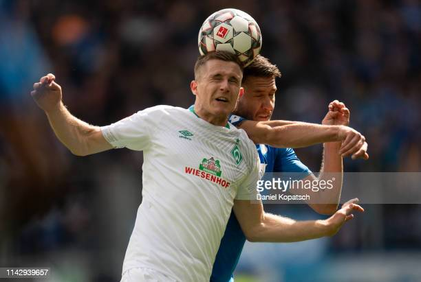 Johannes Eggestein of Bremen jumps for a header with Ermin Bicakcic of Hoffenheim during the Bundesliga match between TSG 1899 Hoffenheim and SV...