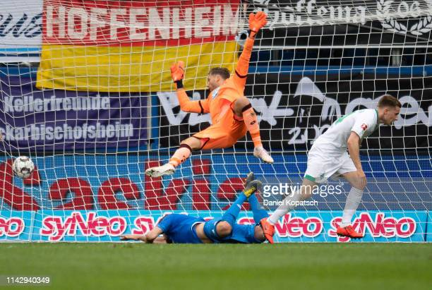Johannes Eggestein of Bremen scores his team's first goal next to Ermin Bicakcic of Hoffenheim and Oliver Baumann of Hoffenheim during the Bundesliga...