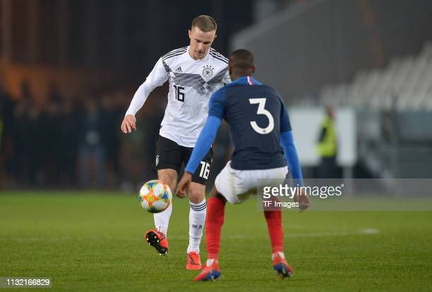 Johannes Eggestein of Germany and Fode BalloToure of France battle for the ball during the International Friendly match between Germany and France at...
