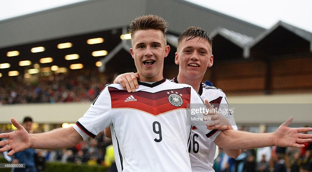 Johannes Eggestein (L) of Germany celebrates with Jonas Busam after scoring his team's fourth goal during the KOMM MIT tournament match between U17 Germany and U17 Italy on September 12, 2014 in Kelheim, Germany.