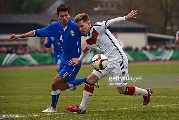 Johannes Eggestein of Germany challenges Alessandro Mattioli of Italy during the UEFA Under17 Elite Round match between U17 Italy and U17 Germany on...
