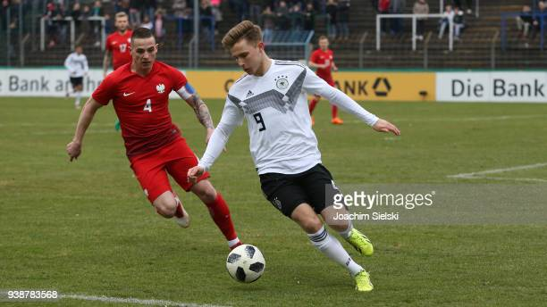 Johannes Eggestein of Germany challenges Ernest Dzieciol of Poland during the international friendly match between U20 Germany and U20 Poland at...