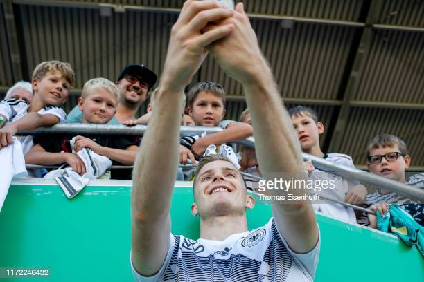 Johannes Eggestein of Germany makes a selfie with the fans after the Germany Under 21 Training Session at Stadion Zwickau on September 04, 2019 in...