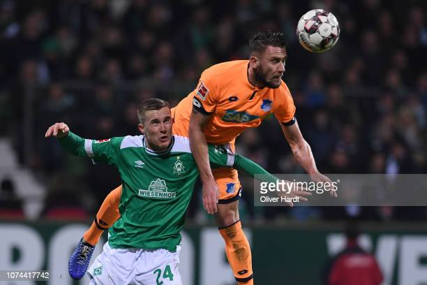 Johannes Eggestein of SV Werder Bremen challenges for the ball with Ermin Bicakcic of TSG 1899 Hoffenheim during the Bundesliga match between SV...