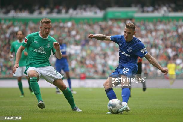 Johannes Eggestein of Werder Bremen and Lucas Digne of FC Everton battle for the ball during the preseason friendly match between SV Werder Bremen...