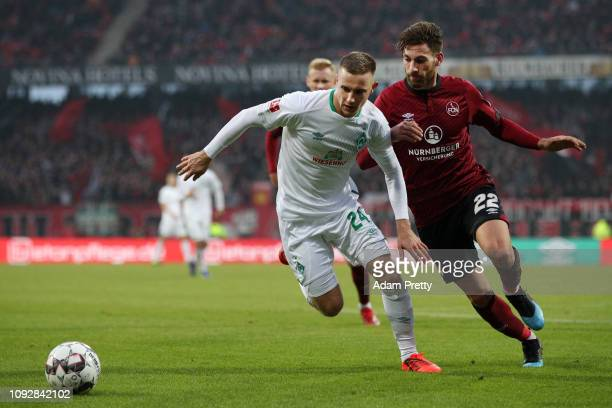 Johannes Eggestein of Werder Bremen is challenged by Enrico Valentini of Nuernberg during the Bundesliga match between 1 FC Nuernberg and SV Werder...