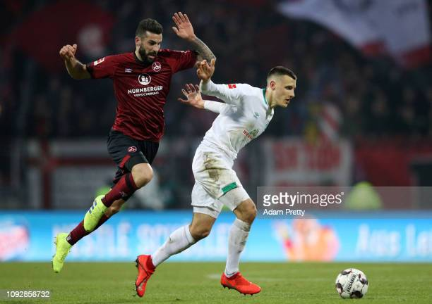 Johannes Eggestein of Werder Bremen is challenged by Mikael Ishak of Nuernberg during the Bundesliga match between 1 FC Nuernberg and SV Werder...