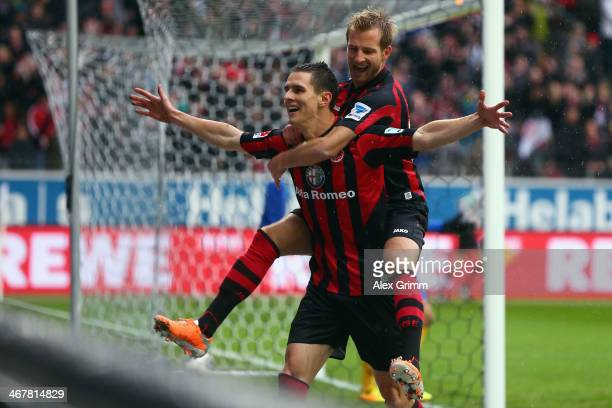 Johannes Flum of Frankfurt celebrates his team's first goal with team mate Stefan Aigner during the Bundesliga match between Eintracht Frankfurt and...