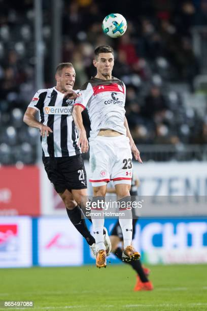 Johannes Flum of St Pauli jumps for a header with Manuel Stiefler of Sandhausen during the Second Bundesliga match between SV Sandhausen and FC St...