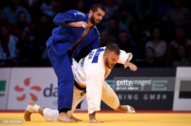 Johannes Frey and Benjamin Fletcher in action during the men's up to 100 kg body weight competition at the Judo Grand Prix in the Mitsubishi Electric...