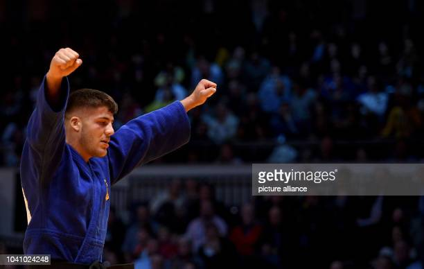 Johannes Frey celebrates after the men's up to 100 kg body weight competition at the Judo Grand Prix in the Mitsubishi Electric Hall in Duesseldorf...
