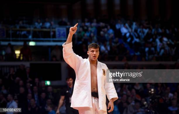 Johannes Frey celebrates his victory over Jose Armenteros from Cuba after the men's up to 100 kg body weight competition at the Judo Grand Prix in...