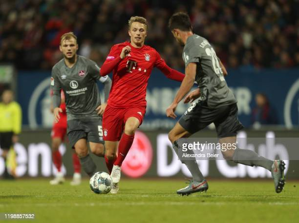 Johannes Geis and Lukas Muehl of 1. FC Nuernberg fight for the ball with Fiete Arp of FC Bayern Muenchen during a friendly match between 1. FC...